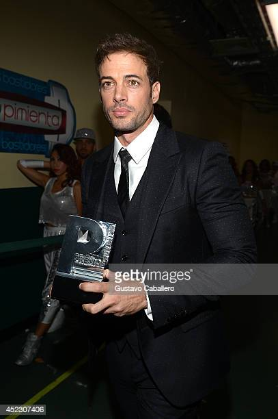 William Levy poses backstage during the Premios Juventud 2014 at The BankUnited Center on July 17 2014 in Coral Gables Florida