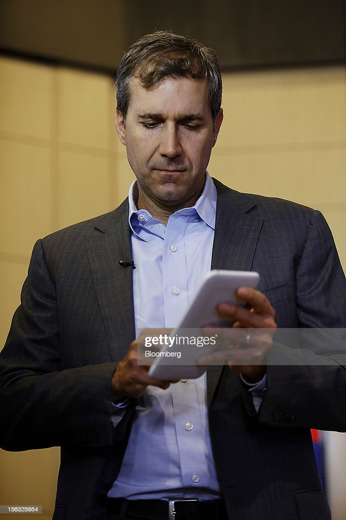 William Lynch, chief executive officer of Barnes & Noble Inc., demonstrates a Nook tablet during an exclusive Bloomberg Television interview in New York, U.S., on Tuesday, Nov. 13, 2012. Lynch discussed the company's performance, outlook and the Nook tablet. Photographer: Victor J. Blue/Bloomberg via Getty Images