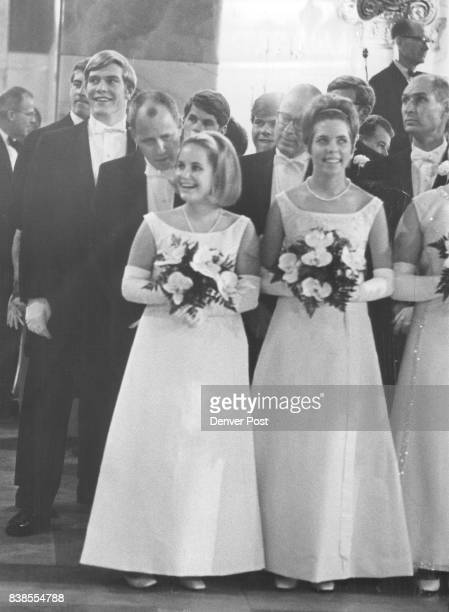 William M Davis whispers to his daughter Ann He's backed by her escorts James Earl Watson III third from front and Frank Hagerman Shafroth Jr...