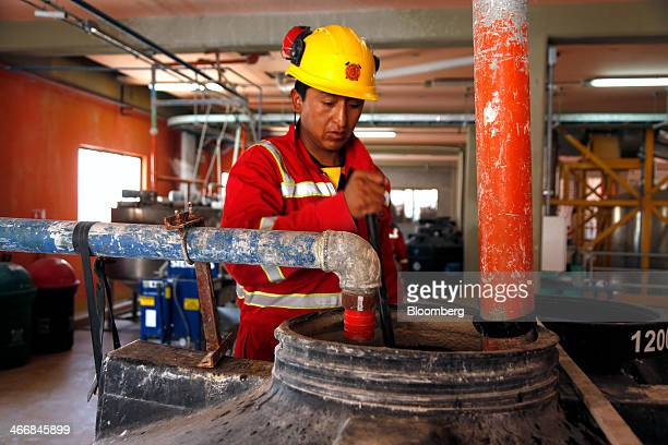 William Mamani works at the state mining company Comibol's lithium production complex in Llipe Bolivia on the edge of the Uyuni Salt Flats on Friday...
