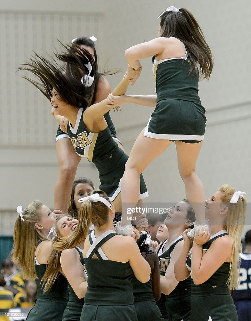 William & Mary cheerleaders perform during the second half between William & Mary and North Carolina-Wilmington at Kaplan Arena in Williamsburg, Virginia, Wednesday, February 13, 2013. William & Mary defeated UNCW, 92-86.