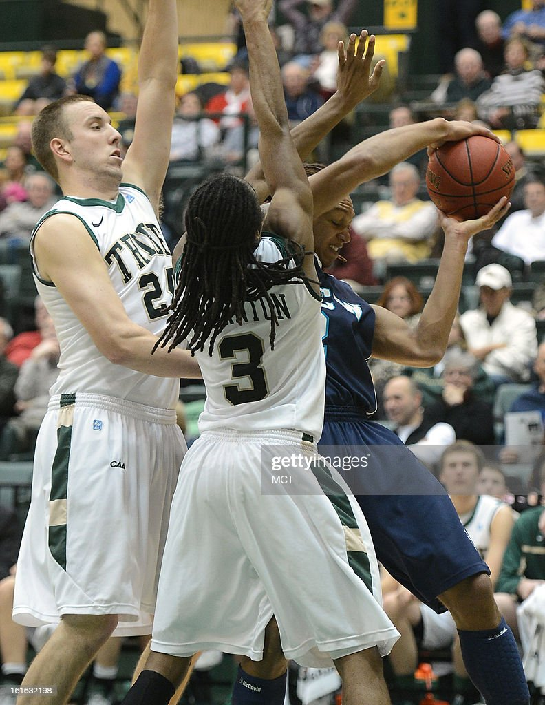 William & Mary forward Fred Heldring (24), left, and William & Mary guard Marcus Thornton (3) turn back a drive along the baseline by North Carolina-Wilmington forward Keith Rendleman (2) in the first half at Kaplan Arena in Williamsburg, Virginia, Wednesday, February 13, 2013.
