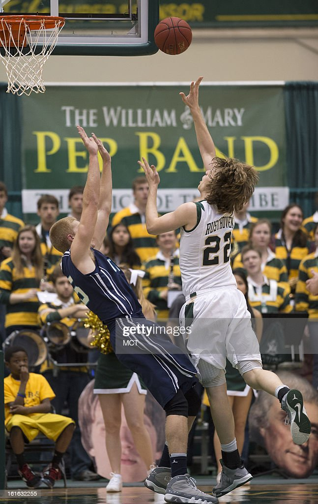 William & Mary forward Tim Rusthoven (22) scores and draws a foul from North Carolina-Wilmington forward Luke Hager (15), left, in the first half at Kaplan Arena in Williamsburg, Virginia, Wednesday, February 13, 2013.