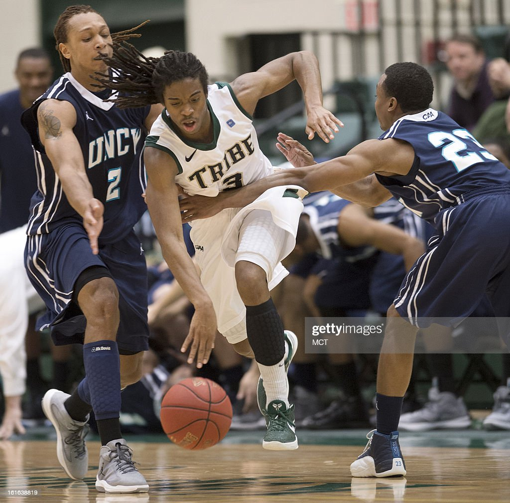 William & Mary guard Marcus Thornton (3) gets fouled by North Carolina-Wilmington guard Craig Ponder (23), as he breaks between North Carolina-Wilmington forward Keith Rendleman (2) and Ponder late in the second half at Kaplan Arena in Williamsburg, Virginia, Wednesday, February 13, 2013. William & Mary defeated UNCW, 92-86.