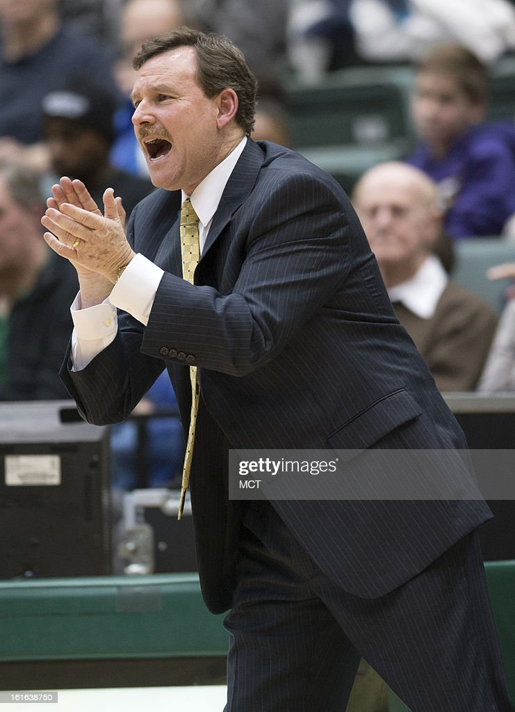 William & Mary head coach Tony Shaver encourages his players during the second half against North Carolina-Wilmington at Kaplan Arena in Williamsburg, Virginia, Wednesday, February 13, 2013. William & Mary defeated UNCW, 92-86.