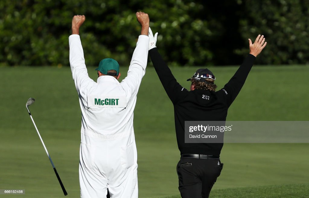 William McGirt of the United States celebrate with caddie Brandon Antus after holing his bunker shot on the fourth hole during the second round of the 2017 Masters Tournament at Augusta National Golf Club on April 7, 2017 in Augusta, Georgia.