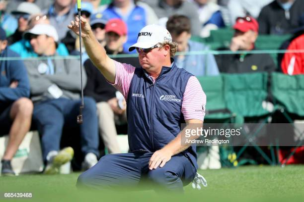 William McGirt of the United States lines up his putt on the 18th green during the first round of the 2017 Masters Tournament at Augusta National...