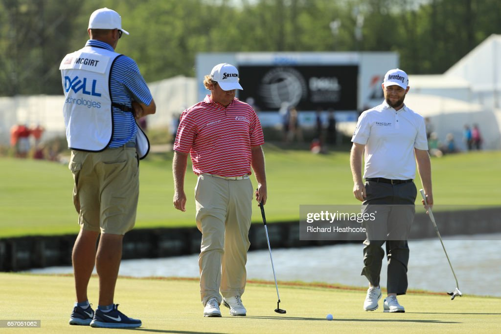 William McGirt (L) watches his ball as it is blown across the green on the 13th hole of his match against Branden Grace of South Africa during round two of the World Golf Championships-Dell Technologies Match Play at the Austin Country Club on March 23, 2017 in Austin, Texas.
