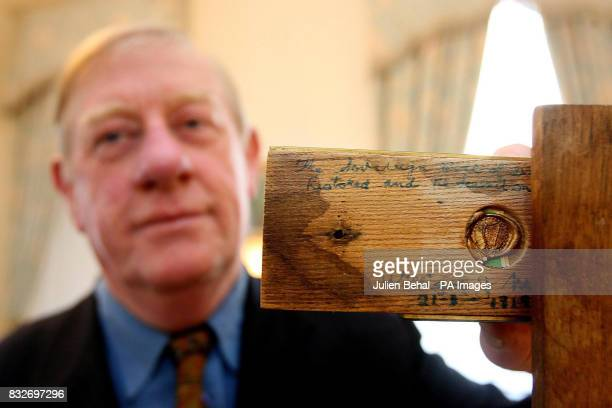 William McGuire of the McGuire clan keepers of the Sovereign Seal of Ireland displays the inscription on the underside of the seal during a ceremony...