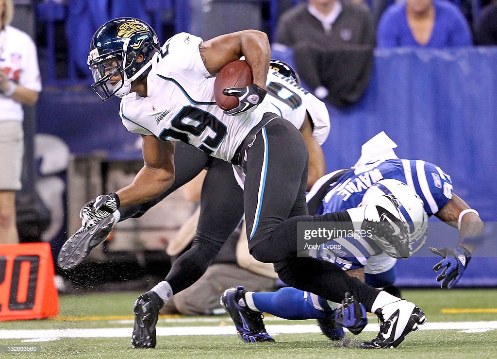 William Middleton #29 of the Jacksonville Jaguars runs with the ball after intercepting a pass during the game against the Indianapolis Colts at Lucas Oil Stadium on November 13, 2011 in Indianapolis, Indiana. The Jaguars won 17-3.