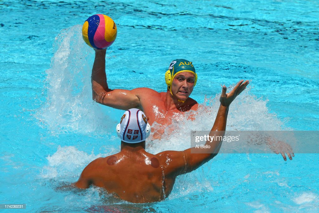 William Miler of Australia looks to pass against <a gi-track='captionPersonalityLinkClicked' href=/galleries/search?phrase=Dusko+Pijetlovic&family=editorial&specificpeople=3083422 ng-click='$event.stopPropagation()'>Dusko Pijetlovic</a> of Serbia during the Men's Water Polo first preliminary round match between Serbia and Australia during day three of the 15th FINA World Championships at Piscines Bernat Picornell on July 22, 2013 in Barcelona, Spain.