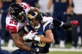 William Moore of the Atlanta Falcons tackles Laurent Robinson of the St Louis Rams at the Edward Jones Dome on November 21 2010 in St Louis Missouri...