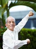 William Ng, a Tai Chi master practicing Tai Chi on the deck