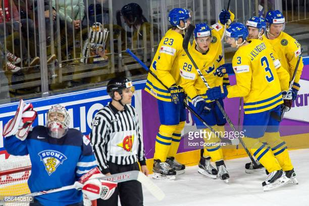 William Nylander celebrates his goal with teammates during the Ice Hockey World Championship Semifinal between Sweden and Finland at Lanxess Arena in...