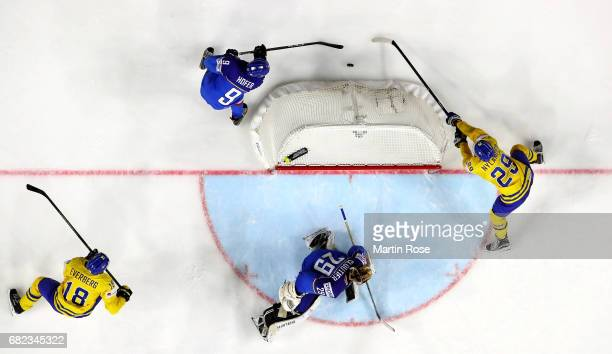 William Nylander of Sweden challenges Armin Hofer of Italy for the puck during the 2017 IIHF Ice Hockey World Championship game between Sweden and...