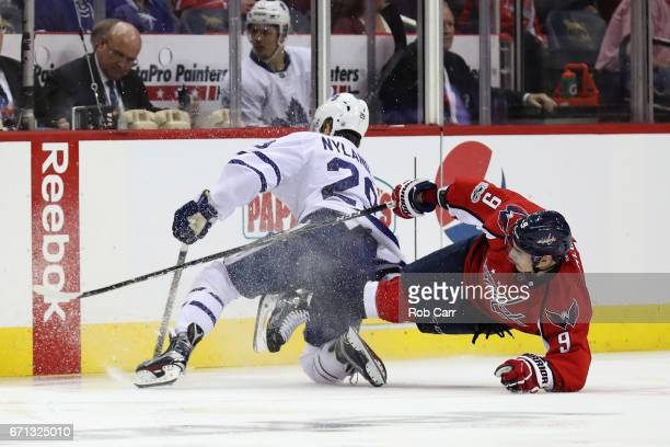William Nylander of the Toronto Maple Leafs and Dmitry Orlov of the Washington Capitals go after the puck in Game Five of the Eastern Conference...