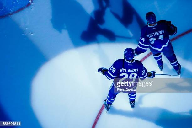 William Nylander of the Toronto Maple Leafs and teammate Auston Matthews during pregame ceremonies prior to an NHL game against the Pittsburgh...