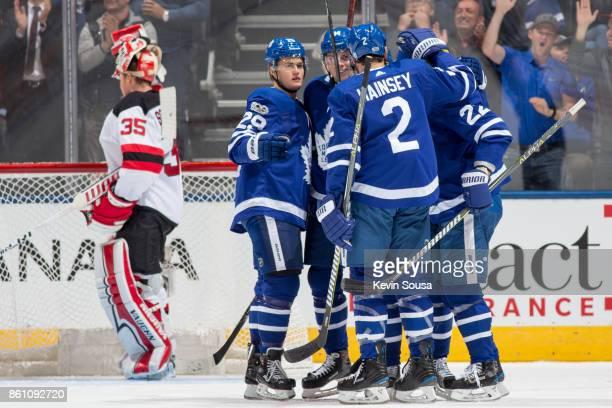 William Nylander of the Toronto Maple Leafs Auston Matthews Ron Hainsey Nikita Zaitsev celebrate Dominic Moore goal against Cory Schneider of the New...
