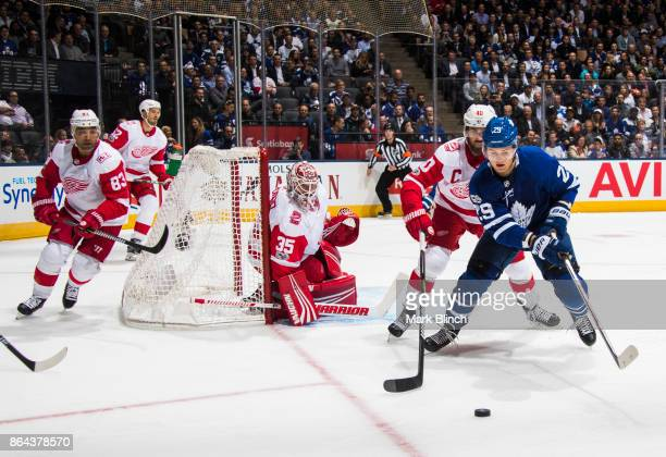 William Nylander of the Toronto Maple Leafs battles with Henrik Zetterberg of the Detroit Red Wings during the first period at the Air Canada Centre...