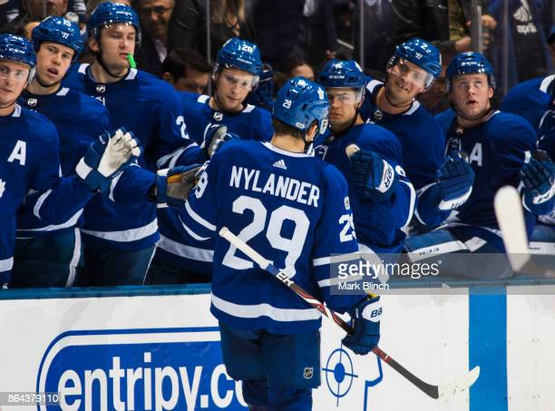 William Nylander of the Toronto Maple Leafs celebrates his goal with the bench against the Detroit Red Wings during the third period at the Air...