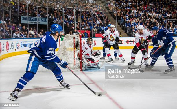 William Nylander of the Toronto Maple Leafs circles the net in front of Craig Anderson of the Ottawa Senators during the first period at the Air...