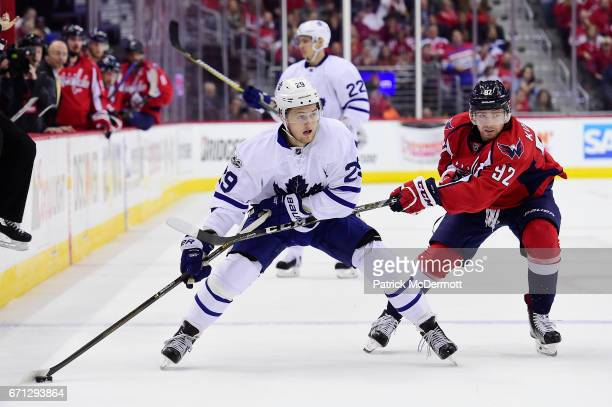 William Nylander of the Toronto Maple Leafs controls the puck against Evgeny Kuznetsov of the Washington Capitals in the second period in Game Five...