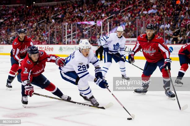 William Nylander of the Toronto Maple Leafs controls the puck against Dmitry Orlov of the Washington Capitals in the second period at Capital One...