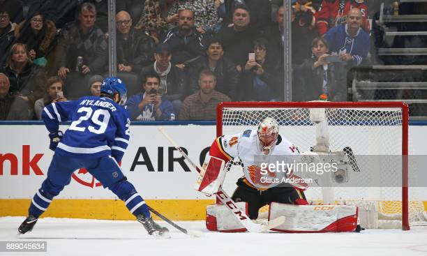 William Nylander of the Toronto Maple Leafs gets set to flip the puck past Mike Smith of the Calgary Flames for the eventual game winner in the...