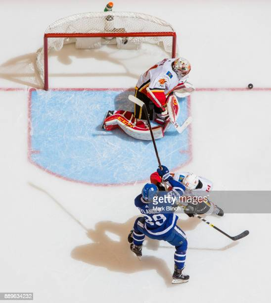 William Nylander of the Toronto Maple Leafs goes to the net against Mike Smith and Brett Kulak of the Calgary Flames during the first period at the...