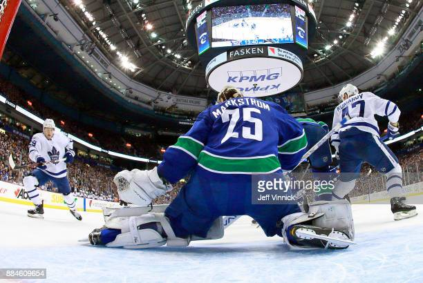 William Nylander of the Toronto Maple Leafs looks on as Jacob Markstrom of the Vancouver Canucks blocks a shot during their NHL game at Rogers Arena...