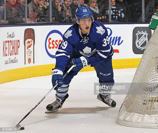 William Nylander of the Toronto Maple Leafs looks to make a pass against the Tampa Bay Lightning during an NHL game at the Air Canada Centre on...