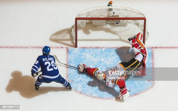 William Nylander of the Toronto Maple Leafs scores the winning goal on Mike Smith of the Calgary Flames during a shootout at the Air Canada Centre on...