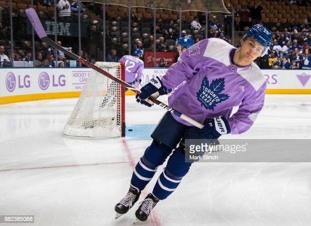 William Nylander of the Toronto Maple Leafs skates in warm up a wearing lavender jersey to support 'Hockey Fights Cancer' before playing the...