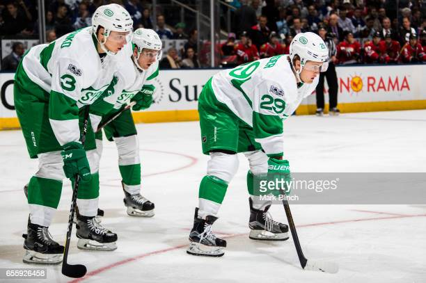 William Nylander of the Toronto Maple Leafs stands for a face off with teammates Alexey Marchenko and Zach Hyman against the Chicago Blackhawks...