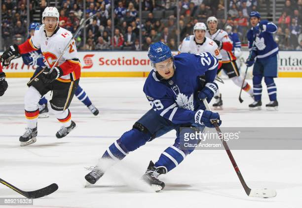William Nylander of the Toronto Maple Leafs turns with the puck against the Calgary Flames during an NHL game at the Air Canada Centre on December 6...