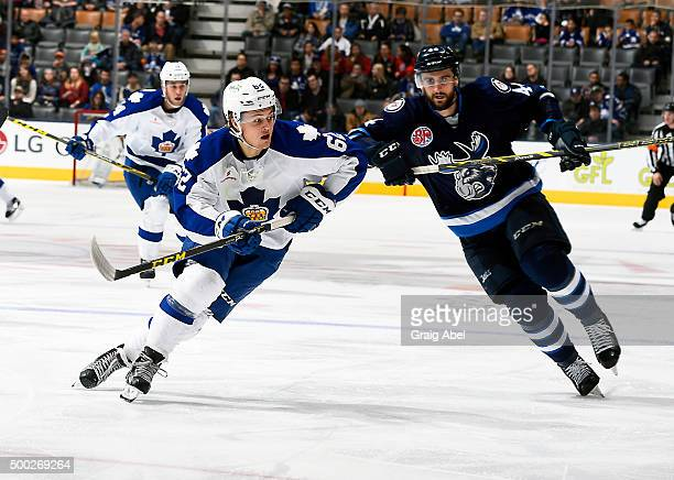 William Nylander of the Toronto Marlies skates past Julian Melchior of the Manitoba Moose during AHL game action on December 6 2015 at the Air Canada...
