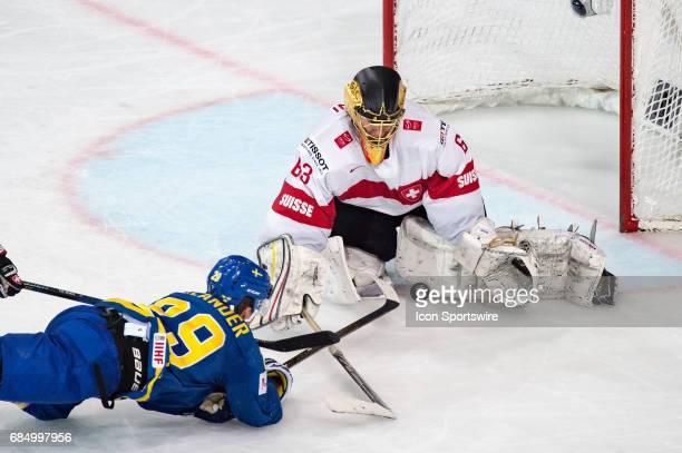 William Nylander scores a goal against Goalie Leonardo Genoni and Christian Marti during the Ice Hockey World Championship Quarterfinal between...