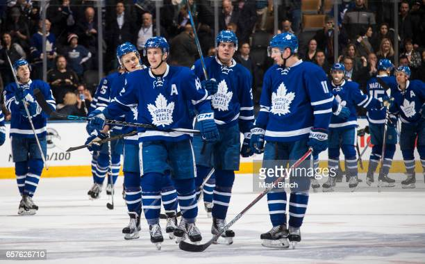 William Nylander Tyler Bozak Auston Matthews and Zach Hyman of the Toronto Maple Leafs celebrate their in against the New Jersey Devils at the Air...