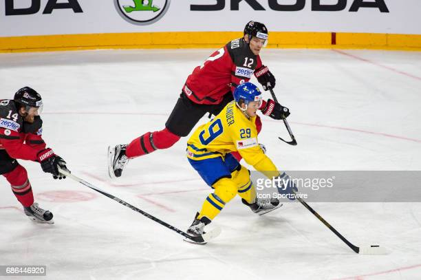 William Nylander vies with Colton Parayko and Sean Couturier during the Ice Hockey World Championship Gold medal game between Canada and Sweden at...