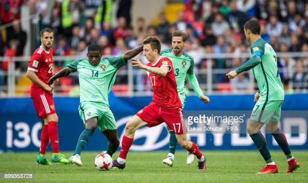 William of Portugal and Aleksandr Golovin of Russia fight for the ball during the FIFA Confederations Cup Russia 2017 Group A match between Russia...