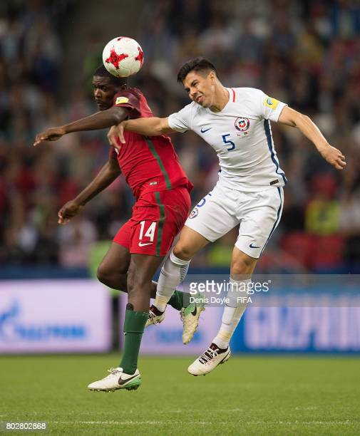William of Portugal battles for the ball against Francisco Silva of Chile during the FIFA Confederations Cup semifinal match between Portugal and...