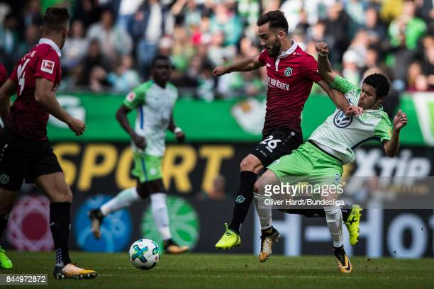 William of Wolfsburg and Kenan Karaman of Hannover compete for the ball during the Bundesliga match between VfL Wolfsburg and Hannover 96 at...