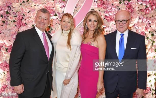 William P Lauder Executive Chariman of The Estee Lauder Companies Suzanne Johnson Elizabeth Hurley and Ambassador Robert W Johnson US Ambassador to...