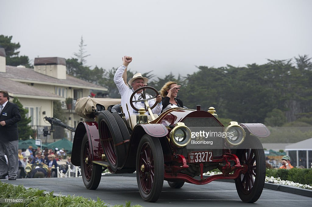 William P. Snyder drives his 1912 Simplex 50HP Holborook Toy Tonneau during the 2013 Pebble Beach Concours d' Elegance in Pebble Beach, California, U.S., on Sunday, Aug. 18, 2013. The annual event in its 63rd year raised $1.277 million U.S. dollars for charity and showcased 248 cars, 48 from abroad. Photographer: David Paul Morris/Bloomberg via Getty Images