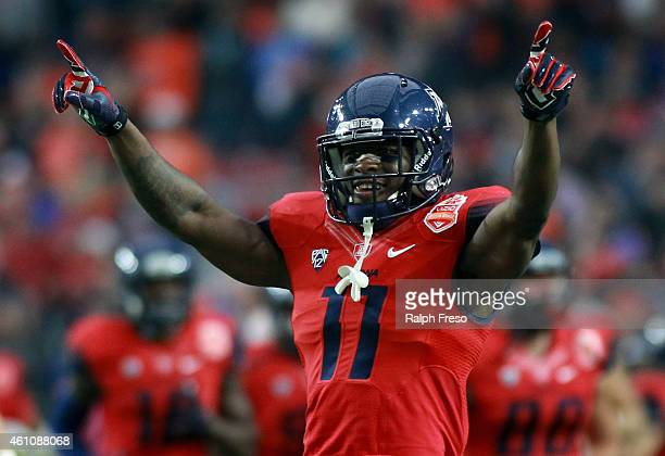 William Parks of the Arizona Wildcats reacts to the crowd during the start of the Vizio Fiesta Bowl between the Arizona Wildcats and Boise State...