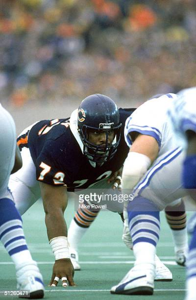 William Perry of the Chicago Bears prepares for a play as he looks over the Detroit Lions offense during a game in 1986 at Soldier Field in Chicago...