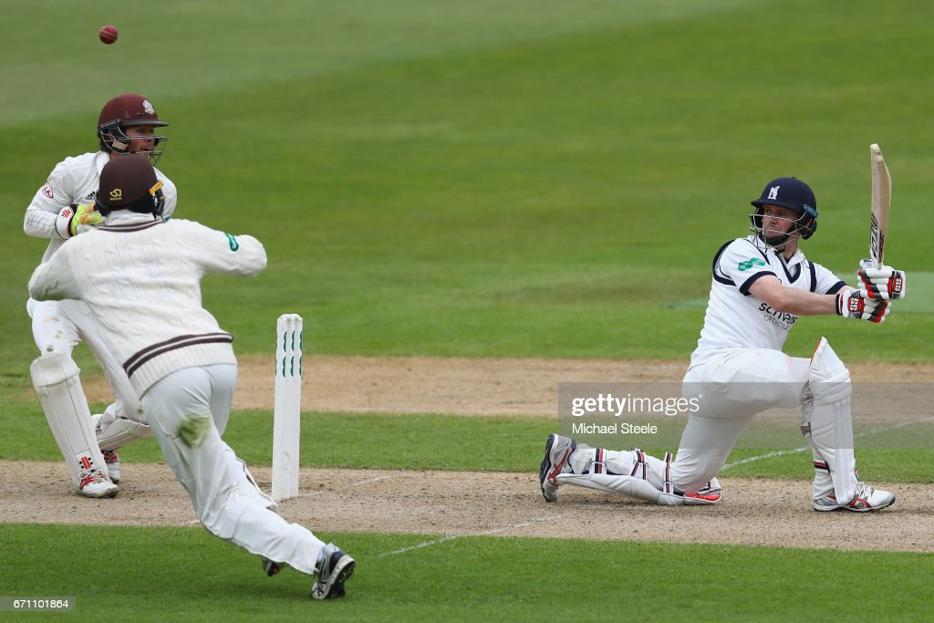 William Portefield of Warwickshire scoops a shot to the legside as wicketkeeper Ben Foakes of Surrey looks on during day one of the Specsavers County Championship Division One match between Warwickshire and Surrey at Edgbaston on April 21, 2017 in Birmingham, England.