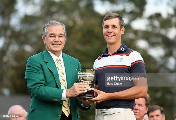 William Porter Payne chairman of Augusta National Golf Club poses with low amateur Oliver Goss of Australia after the final round of the 2014 Masters...