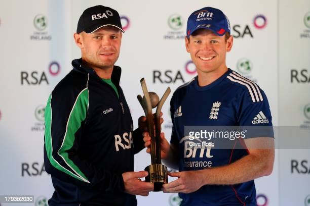 William Porterfield of Ireland and Eoin Morgan of England pose together with the series trophy prior to an England nets session at the castle ground...