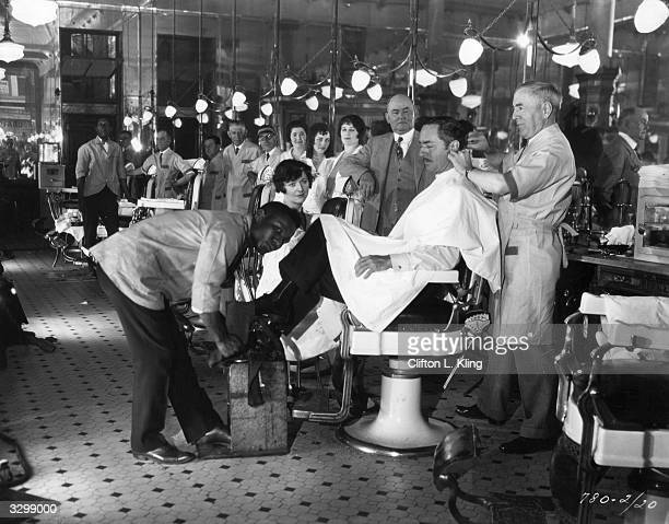 William Powell at a barbershop which was used during the filming of 'Street Of Chance' directed by John Cromwell for Paramount